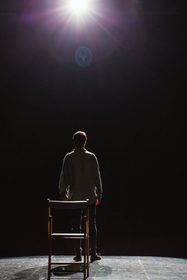 Back View Of An Actor Performing A Play.